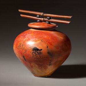 Linda Dalton jar with bamboo handle.