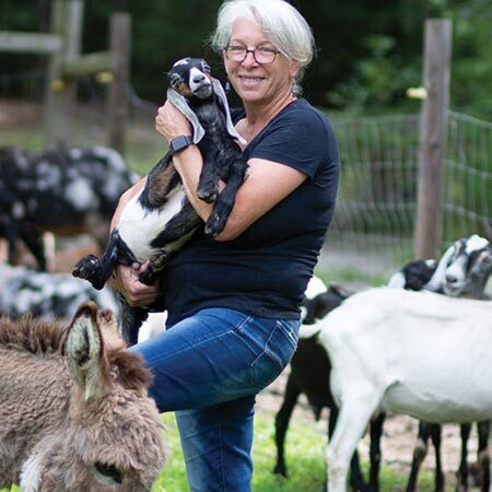 Sue Stovall with her herd of goats